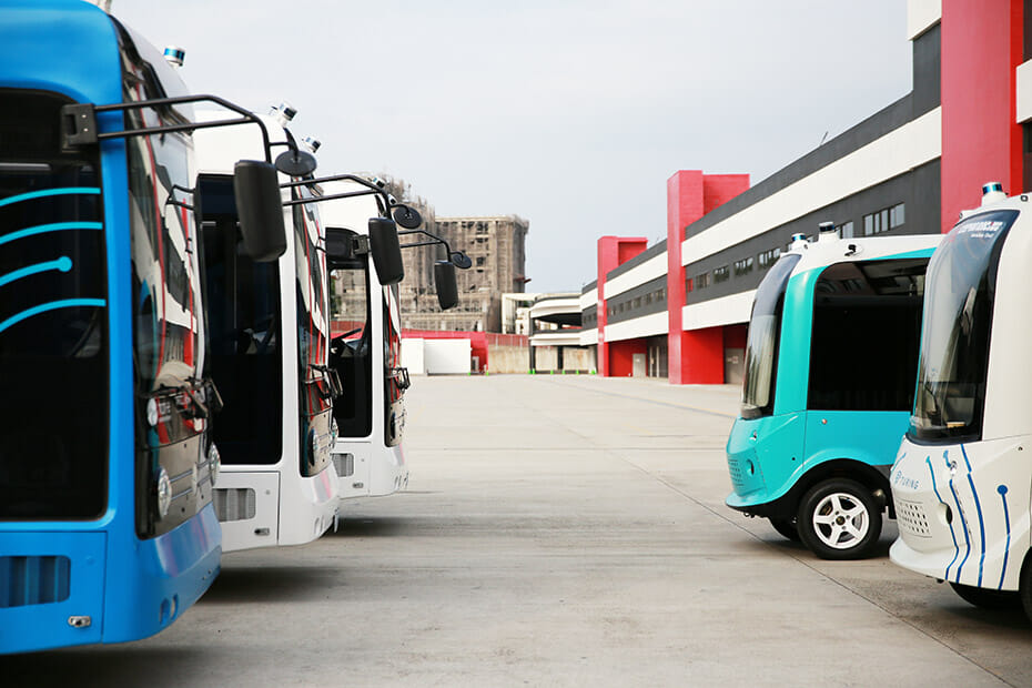 TURING Drive's Autonomous Shuttle Fleet, including 6-meter SAPPHIRE and 3-meter OPAL buses, with Velodyne Puck lidar sensors